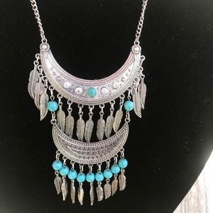 Turquoise color Jewlery with silver tone feathers